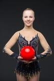 有红色球的Gymnastist女孩 库存照片