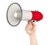 有红色白色手提式扬声机扩音机的手 库存图片