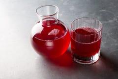 有红色的玻璃瓶子 库存照片