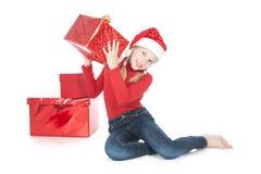 有红色礼品的十几岁的女孩在白色 免版税库存照片