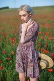 有红色花时尚画象的妇女农夫 免版税库存图片