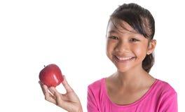 有红色苹果计算机的IV年轻亚裔马来的少年 库存照片