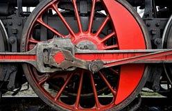 有红色轮幅的红色钢轮子 免版税库存图片