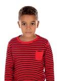 有红色镶边衬衣的美丽的拉丁孩子 库存图片