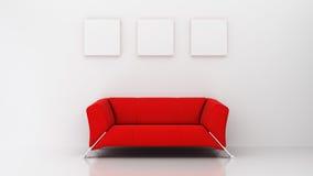 有红色长沙发和三个画框的最低纲领派客厅 免版税库存照片