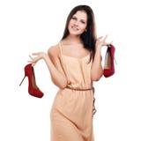有红色鞋子的少妇 免版税库存图片