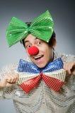 有红色鼻子的滑稽的小丑 库存图片