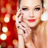 有红色嘴唇的魅力妇女 库存照片