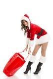有红色购物袋的圣诞老人女孩 免版税图库摄影
