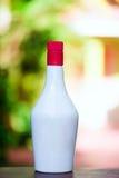 有红顶的白色瓶 免版税库存照片