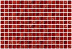 有红颜色作用的小大理石方形的瓦片 库存图片