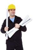 有纸卷的微笑的工程师在手中 免版税库存图片