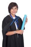 有纸卷的年轻学生毕业生 库存照片