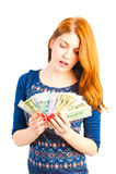 有纸币爱好者的女孩  图库摄影