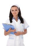 有纸张的俏丽的护士 免版税库存照片