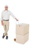 有纸板箱的确信的送货人 库存图片