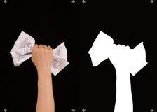 有纸的手在黑背景和面具 免版税库存照片