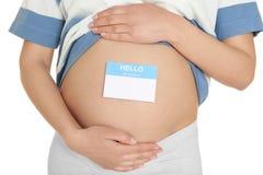 有纸贴纸的孕妇在肚子 免版税库存照片