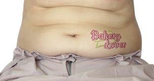 有纹身花刺的腹部 免版税库存图片