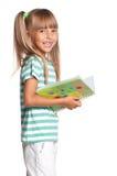 有练习簿的小女孩 库存照片