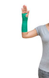 有绿色在手边被熔铸的和胳膊的伤害妇女佩带的运动服, 库存照片