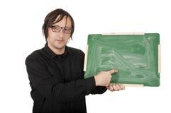 有绿色董事会的人 免版税库存照片