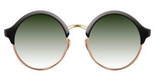 有绿色透镜和金金属框架的太阳镜 库存照片