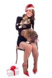 有缅因树狸猫的圣诞老人宝贝 免版税图库摄影