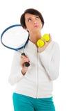 有网球拍的查出的女孩和bal 免版税库存照片