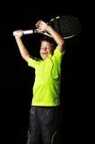 有网球设备庆祝的英俊的男孩 免版税库存照片