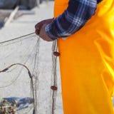 有网的渔夫 库存照片