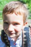 有罗马尼亚农民的孩子使用的心情 图库摄影