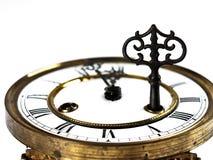 有罗马数字和钥匙的老时钟 免版税库存图片