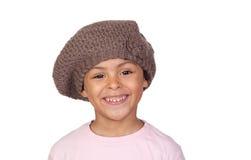 有羊毛帽子的愉快的非洲子项 图库摄影