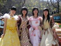 有美丽的礼服的美丽的中国女孩 免版税库存照片