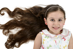 有美丽的头发的美丽的微笑的女孩 免版税库存照片