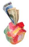 有美元和欧元的五颜六色的moneybox房子 免版税库存图片