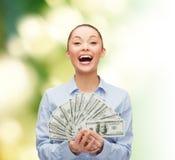 有美元现金金钱的笑的女实业家 免版税库存照片