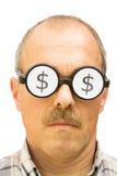 有美元的符号的人在他的玻璃 库存照片