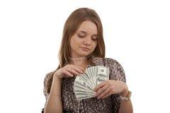 有美元的美丽的女孩在手上 库存图片