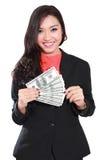 有美元的年轻女实业家在她的手上 免版税库存图片