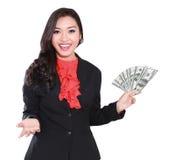 有美元的年轻女实业家在她的手上 库存图片