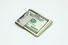 有美元钞票的银色金钱夹子 库存照片