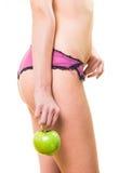 有美味的身体和苹果的女孩在手中 库存照片