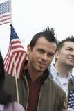 有美国国旗的年轻人 免版税库存照片