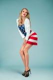 有美国国旗的画报女孩 免版税库存图片