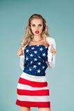 有美国国旗的画报女孩 库存图片