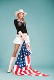 有美国国旗的画报女孩 免版税库存照片
