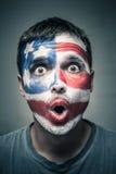 有美国旗子的惊奇的人在面孔 免版税库存图片