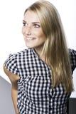 有美好的微笑的白肤金发的妇女 库存照片